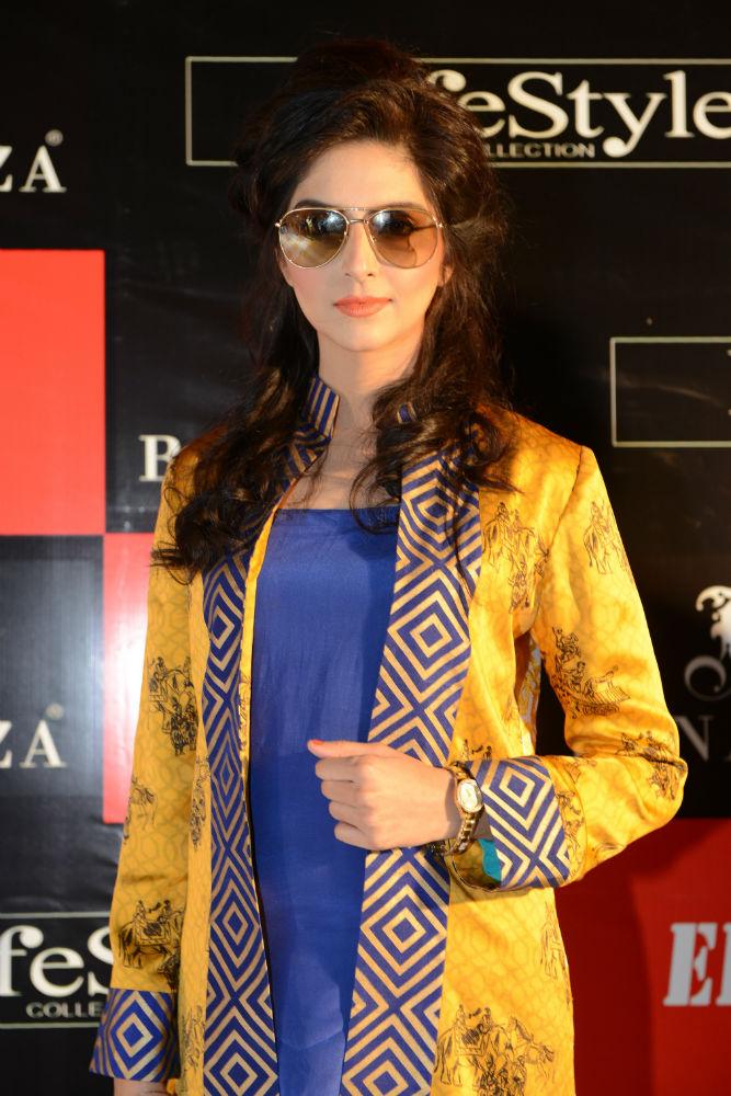 9009ddc1523 Sana Khan wearing a sunglass from Burberry Gold Folding Aviator ...